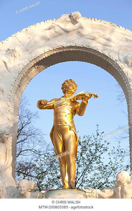 Statue golden playing violin Johann Strauss Vienna