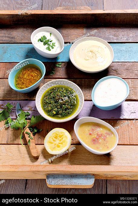 Salsa verde, mayonnaise, French dressing, vinaigrette and a potato and yoghurt dressing