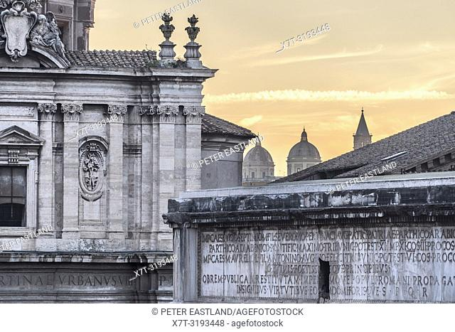 Rome skyline seen from the Roman Forum with the Arch of Septimius Severus right foreground, and the church of Santi Luca e Martina on the left, Central Rome