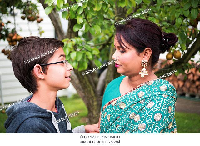 Mother and son talking in garden