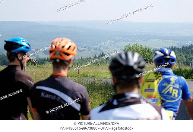 """15 June 2018, Nová Ves V Horách, Czech Republic: A group of German cyclists look onto the Erz mountains while doing the route """"""""Stoneman Miriquidi Road"""""""""""
