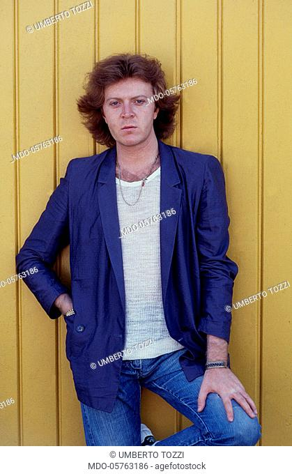 Italian singer-songwriter Umberto Tozzi with one hand in pocket. 1979