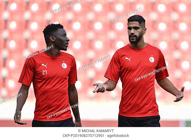 L-R Ibrahim Benjamin Traore and Abdulla Yusuf Helal attend a training session of SK Slavia Prague team prior to the UEFA Champions League