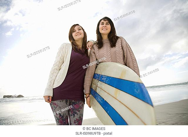 Two girls with surfboard, portrait