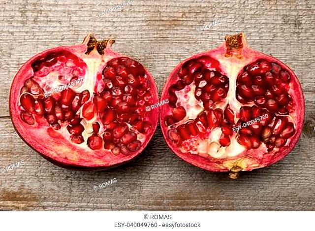 A pomegranate on wood