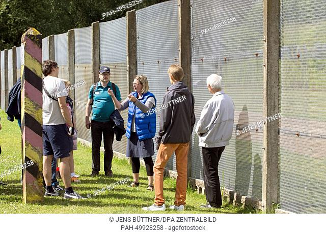Students and other people interested in the history listen to political scientist Sandra Pingel-Schliemann (C) explaining the border installations during a...