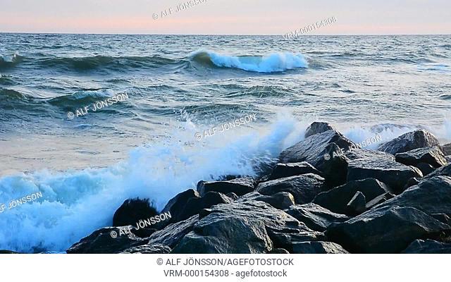 Waves splash at stones