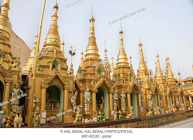 Shires surround the central stupa in the Shwedagon Pagoda. Yangon, Myanmar