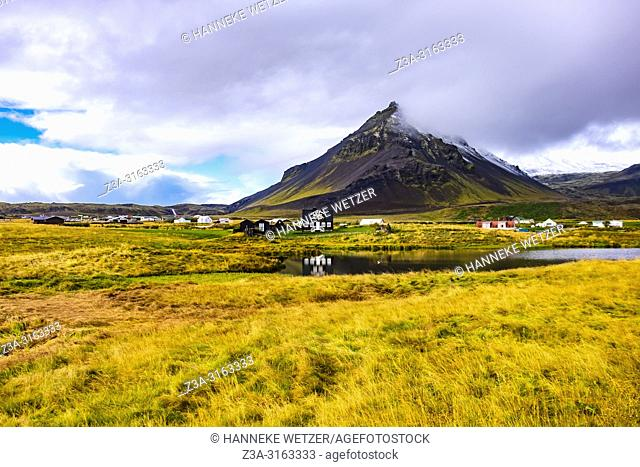 Mt. Stapafell behind the village of Arnarstapi with the Amtmannshúsið house, Snaefellsnes peninsula, Iceland