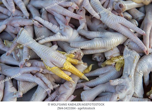 Fresh slaughtered chicken feet for sale at the daily morning street market in Yogyakarta in Java in Indonesia