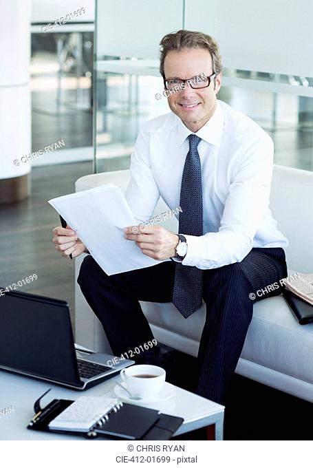 Businessman working in office lobby