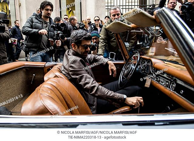 Italian actor Pierfrancesco Favio at start of the Milan-Sanremo vintage car race in Milan, ITALY-22-03-2018