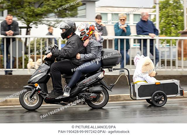 28 April 2019, Bavaria, Kulmbach: A cuddly toy in a trailer accompanies motor scooter riders on the traditional motorbike star ride