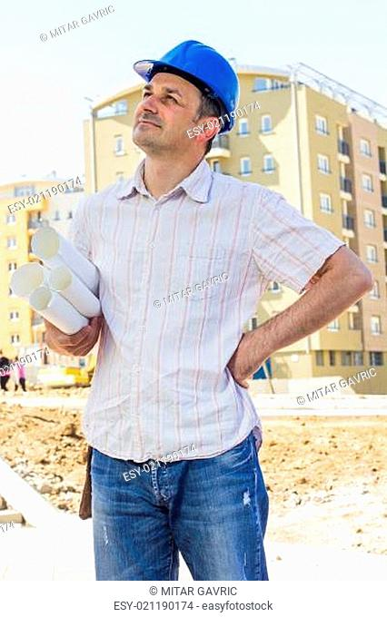 Construction manager holding project on site