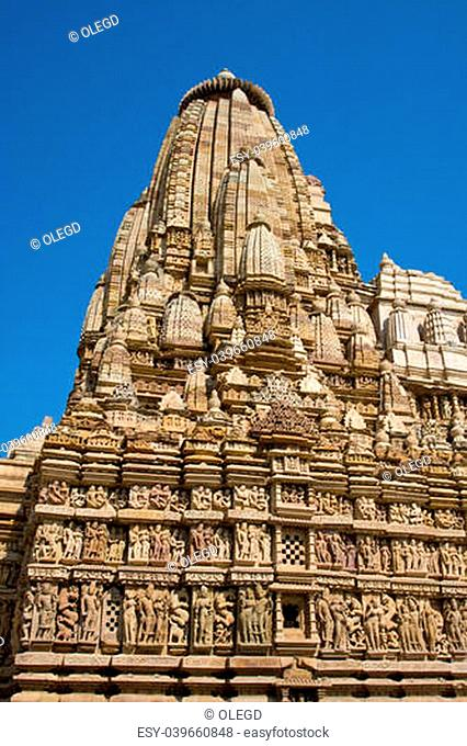 Stone carved temple with erotic sculptures in Khajuraho, Madhya Pradesh, India