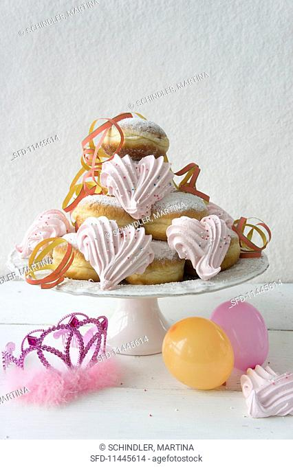 Doughnuts with pink meringues, paper streamers, balloons, and a tiara