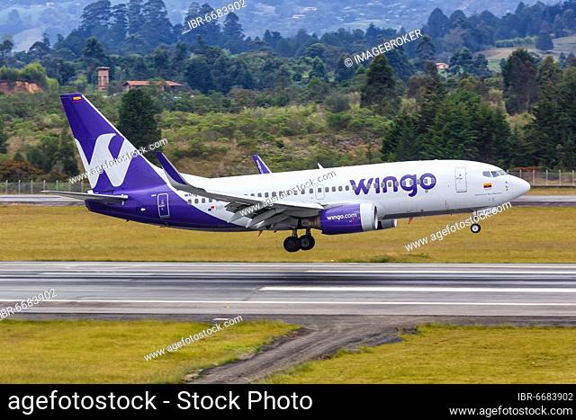 A Wingo Boeing 737-700 aircraft with registration number HP-1525CMP lands at Medellin Rionegro Airport (MDE), Medellin, Colombia, South America