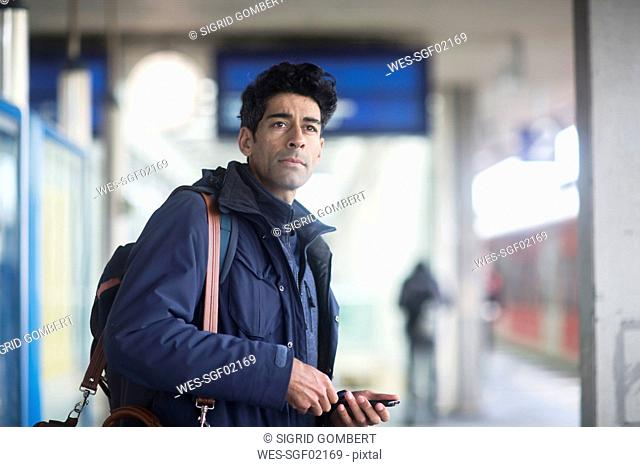 Portrait of man waiting on platform