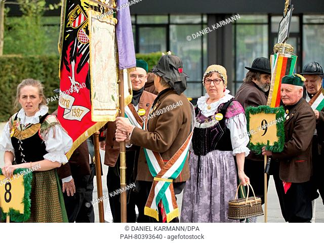 People in traditional costume wait for the groups fo arrive at the 67th Sudeten-Germans Day in Nuremberg, Germany, 15 May 2016