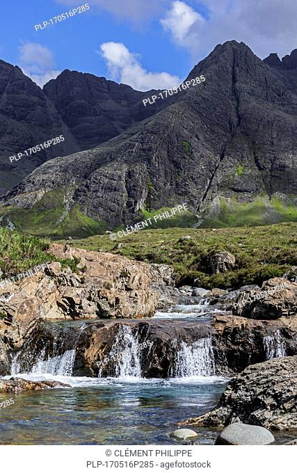 Waterfall of the Fairy Pools in front of the Black Cuillin in Glen Brittle on the Isle of Skye, Scottish Highlands, Scotland, UK