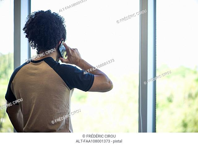 Man enjoying view while taking phone call