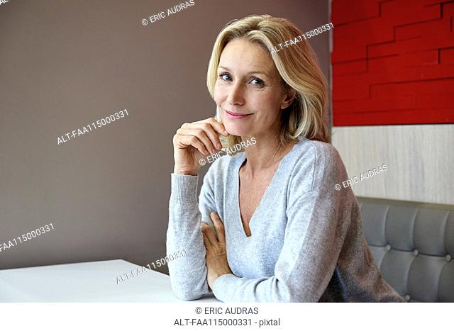 Smiling woman sitting in café