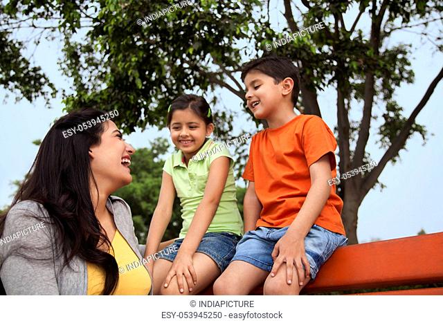 Mother and her two children enjoying outdoors