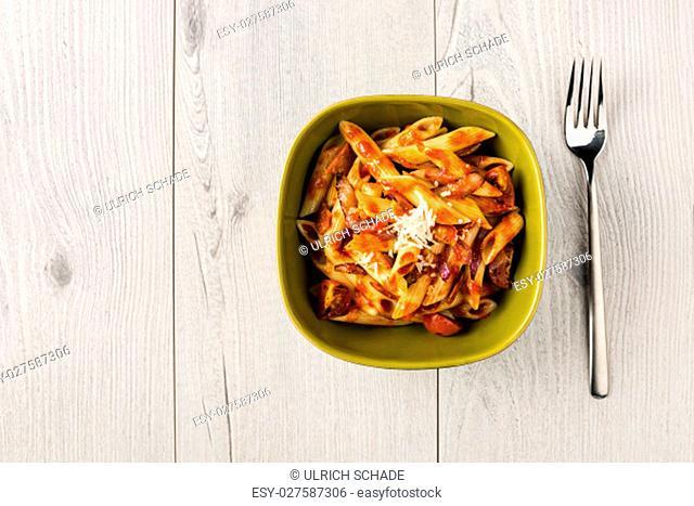 Penne Pasta with Chorizo Creamy Tomato Sauce on White Table Top