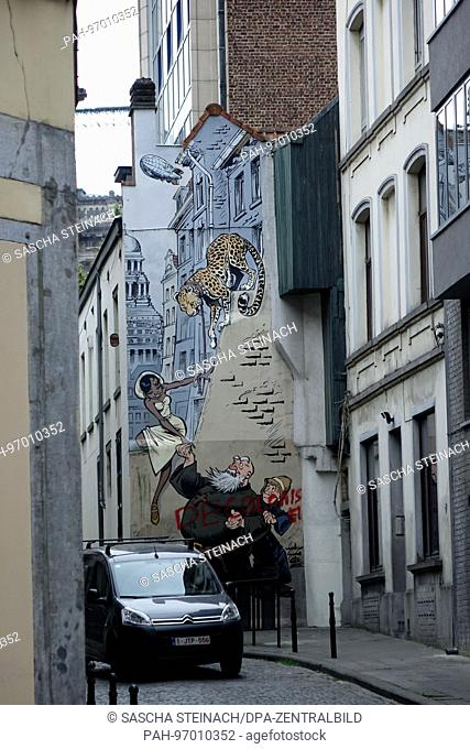 A street artwork showing a clergyman, a woman and a leopard, on the wall of a building in the Belgian capital Brussels, 24.06.2017