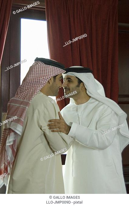 Greeting nose stock photos and images age fotostock two arab business men using traditional bedouin greeting dubai united arab emirates m4hsunfo