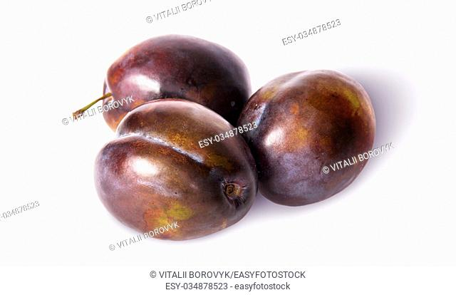 Three violet plums isolated on white background