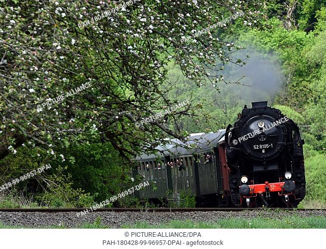 dpatop - 27 April 2018, Germany, Trier: A steam train travelling with guests on the route from Gerolstein to Trier. From the 28 April to the 01 May 2018