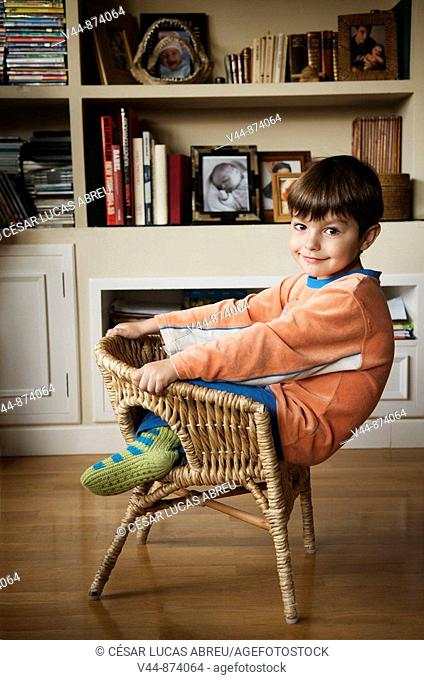 5 years old boy wearing pijama at home