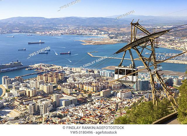 View over the Bay of Gibraltar from the Rock of Gibraltar showing the tourist styled cable car travelling from Gibraltar town to the top of the Rock