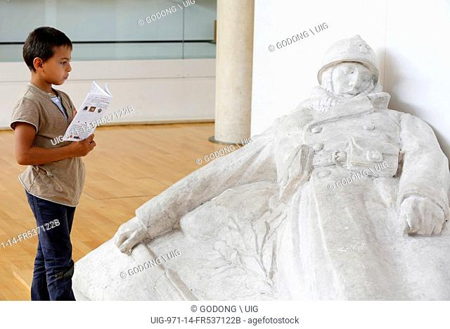 7-year-old schoolboy looking at a sculpture by Emile Pinchon at the Historial de la grande guerre museum, Peronne, Somme