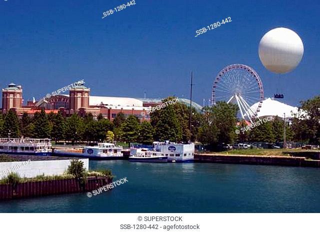 Hot air balloon near a ferris wheel, Navy Pier, Lake Michigan, Chicago, Illinois, USA