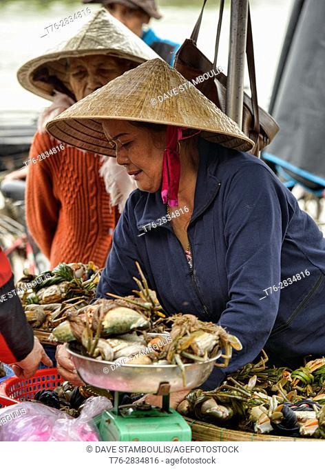 Crab vendor in the fish market, Hoi An, Vietnam