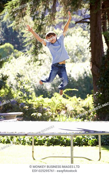 Young Boy Having Fun On Trampoline