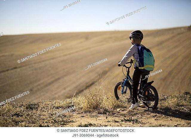 Boy riding bicycle. Ajalvir. Madrid Province. Spain