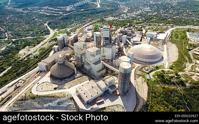 Verkhnebakansky cement plant, top view. Factory for the production and preparation of building cement. Cement industry