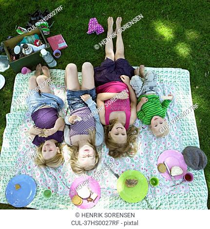 Children laying on picnic blanket