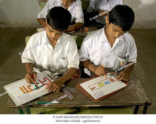 Boys in classroom of school at Ralegan Siddhi near Pune ; Maharashtra ; India