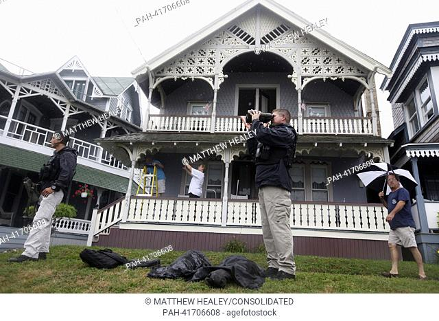 United States Secret Service agents keep watch on Lake Avenue while United States President Barack placed take-out order at Nancy's Restaurant in Oak Bluffs