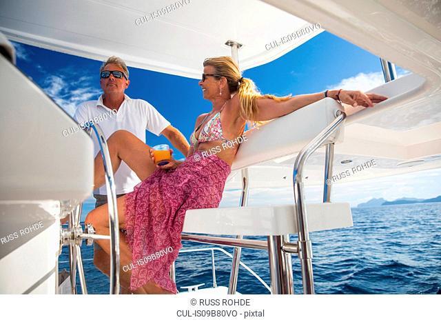 Couple relaxing on yacht, Ban Koh Lanta, Krabi, Thailand, Asia
