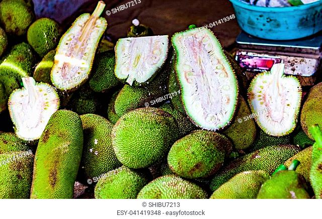 heap of raw and cut kathal jackfruit echor in retail vegetable super market for sale