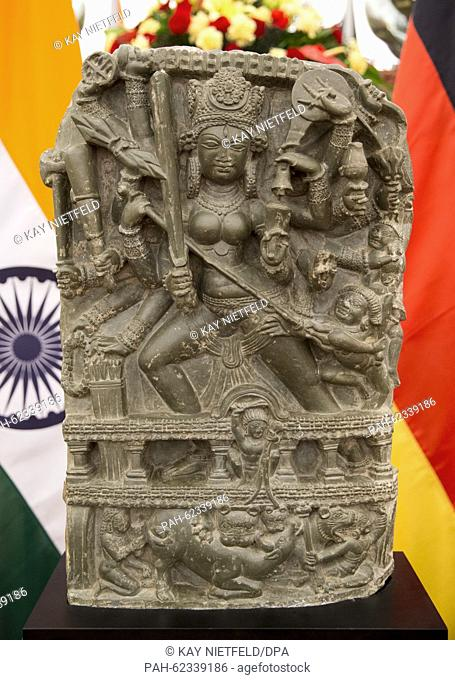 The statue of Hindu goddess Durga is seen between German and Indian flags at the Indian Prime Ministers guest house 'Hyderabad House' in New Dehli, India