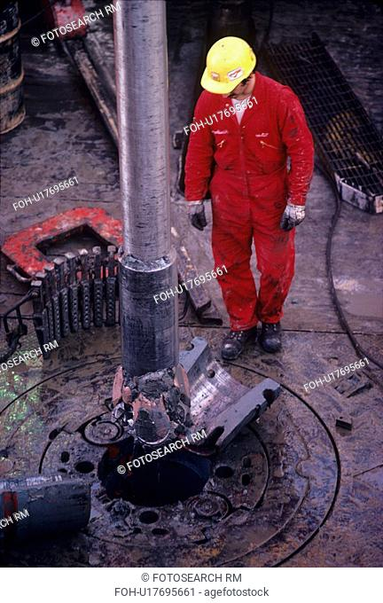 Drilling Rig Worker Setting Slips on Drill Pipe