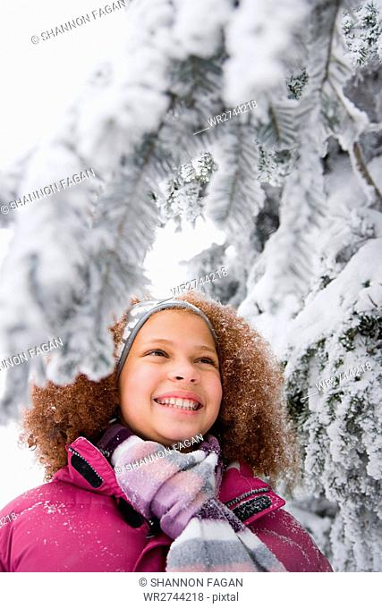 Girl and snowy branches