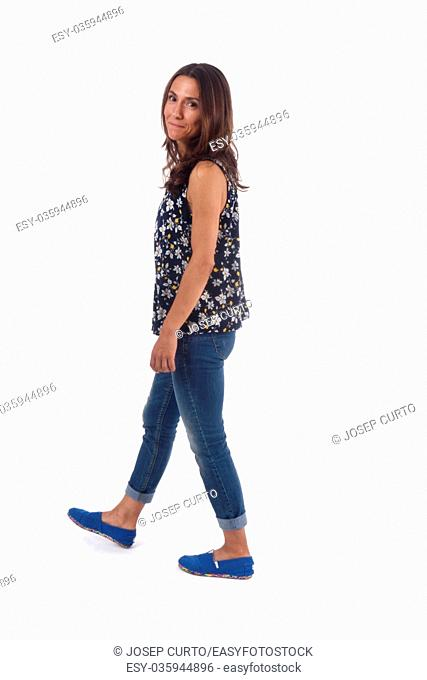 Woman walking on a white background