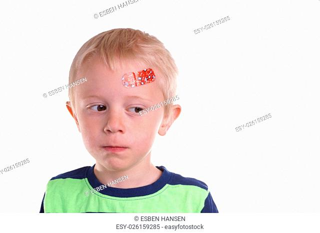 Child gets injury on the forehead has a plaster on the wound so it can heal